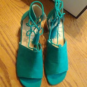 Turquoise lace-up tassle shoes